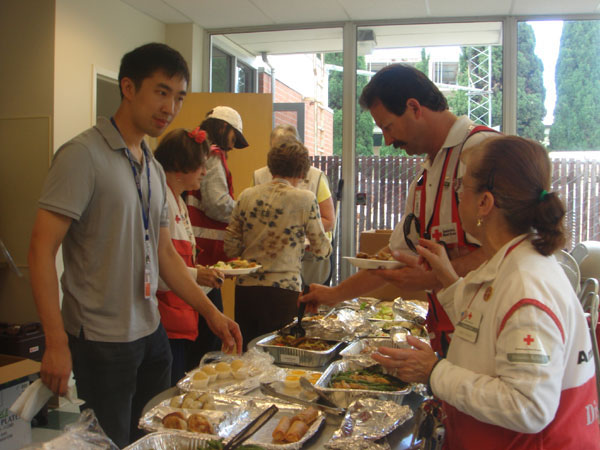 Fung Lum Corporate Manager Parnell Pang delivers food to Red Cross volunteers and staff
